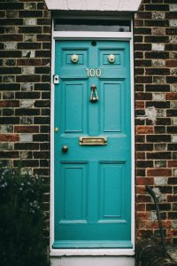 teal-wooden-panel-door